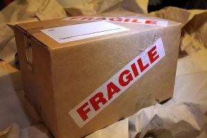 A moving box with the word fragile on it.