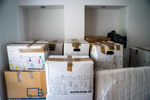 A lot of packed cardboard moving boxes.